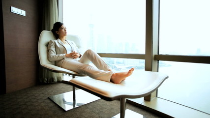 Female Asian Chinese Business Traveller Penthouse Shanghai Recliner