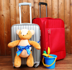 Suitcases with teddy bear and child toys