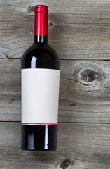 Red Wine Bottle on weathered wood