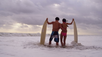 Healthy Young Surfing Couple Living Outdoor Beach Lifestyle