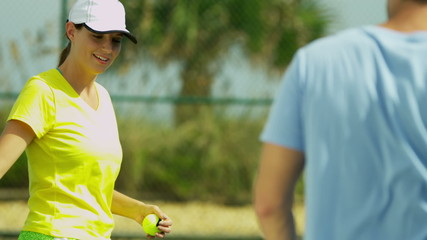 Young Caucasian Male Female Tennis Coach Player
