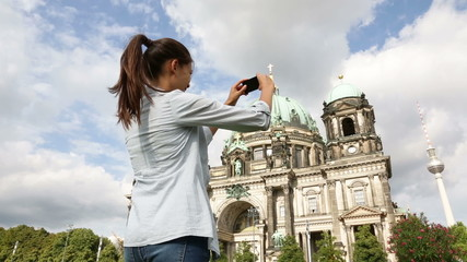 Travel woman taking photograph in Berlin Germany