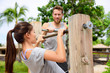 Fitness couple training on chin-up bar together