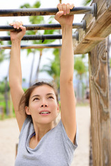 Woman training on fitness ladder monkey bars