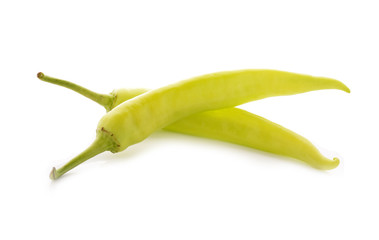 green chili peppers with stem on white background