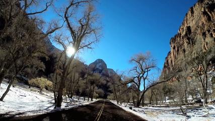 POV road trip driving valley landscape extreme climate snow Zion National Park Utah USA