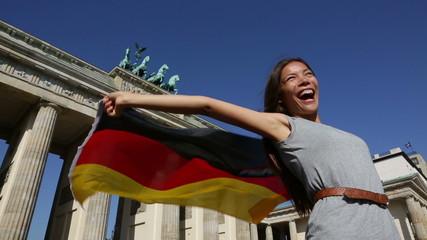 German flag woman joy at Berlin Brandenburger Tor