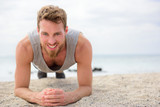 Core exercise - fitness man doing plank outside