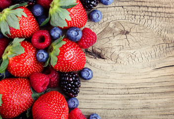 Berries on Wooden Background. Strawberries, Blueberry