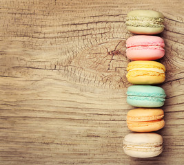 Colorful French Macaroon on wooden background