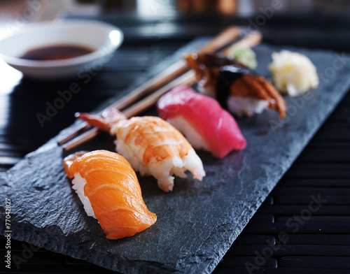 Deurstickers Vis assorted sushi nigiri on slate