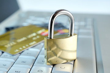 credit card and gold padlock