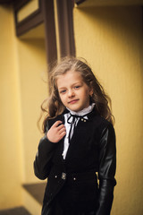 portrait of a girl in coat with curly hair