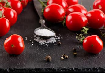 Fresh ripe  tomatoes on   black background