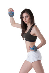 Young athletic woman with wrist weights
