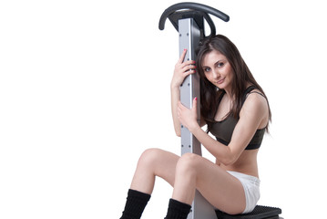 Young athletic woman with massage machine