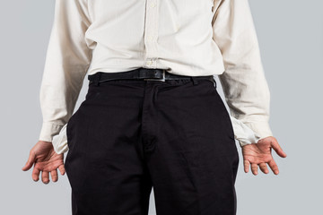 Men gesturing empty pocket with both hands