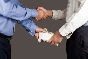 Man exchange envelope of money with hand shake