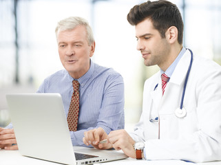Male doctor and his patient