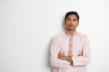 traditional indian male portrait with plain background and copys