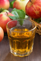 apple cider or juice in a glass, vertical, selective focus