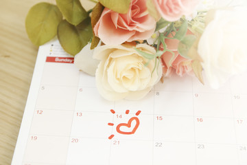 roses and the calendar with the date of February 14 Valentine's