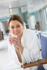 Woman in thalassotherapy center drinking hot tea