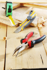 Pliers and a cutter lie on the workbench