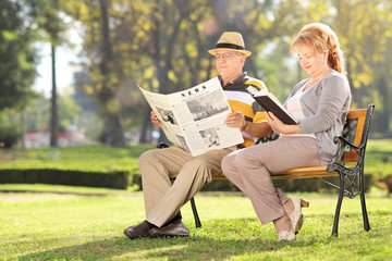 Mature couple relaxing on a bench in park
