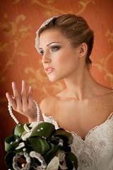 Portrait of Beautiful Elegant Bride with Bouquet