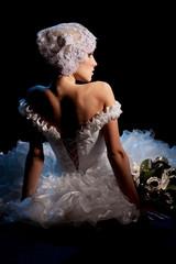 Portrait of Beautiful Elegant Bride Sitting with Bouquet