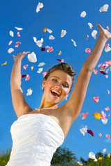 Happy Bride and Colorful Petals at the Blue Sky