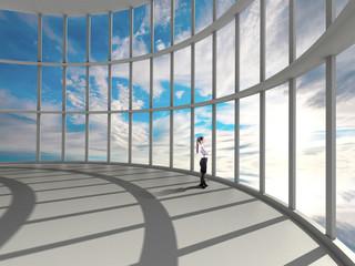 businesswoman  looking at sky in window
