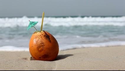 Fresh coconut on the sea beach.