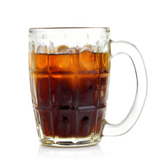 cola in the glass on white background