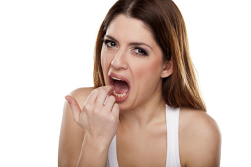 disgusted woman puts her fingers in her mouth