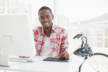 Casual businessman using digitizer and computer