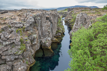National Park of Thingvellir in Iceland, water and rocks