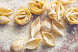 Leinwanddruck Bild - raw pasta and flour