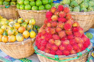 Baskets of tropical fruit on a street market