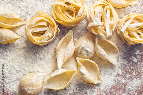 raw pasta and flour - 77055081