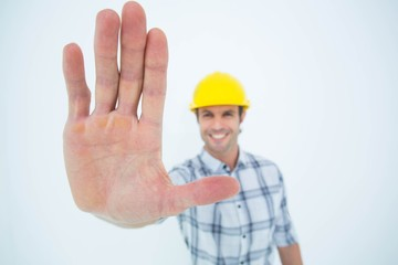 Carpenter showing palm over white background