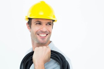 Handsome electrician carrying wires