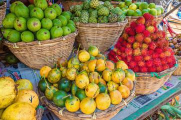 Baskets with tropical fruit: rambutan, passion fruit