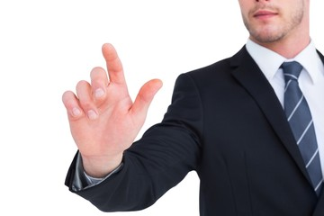 Focused businessman pointing with his finger