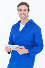 Handsome mechanic holding digital tablet