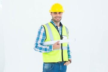 Portrait of smiling architect holding blueprint