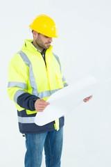 Architect analyzing blueprint