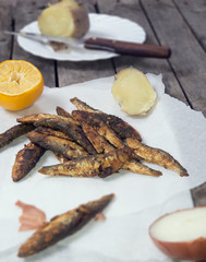 Vertical image of fried smelt fish