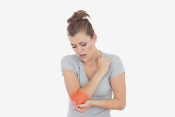 Unhappy woman with elbow pain